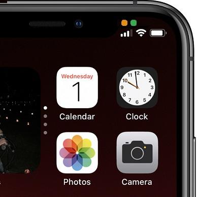 لماذا النقاط الخضراء والبرتقالية على شاشة الايفون ؟